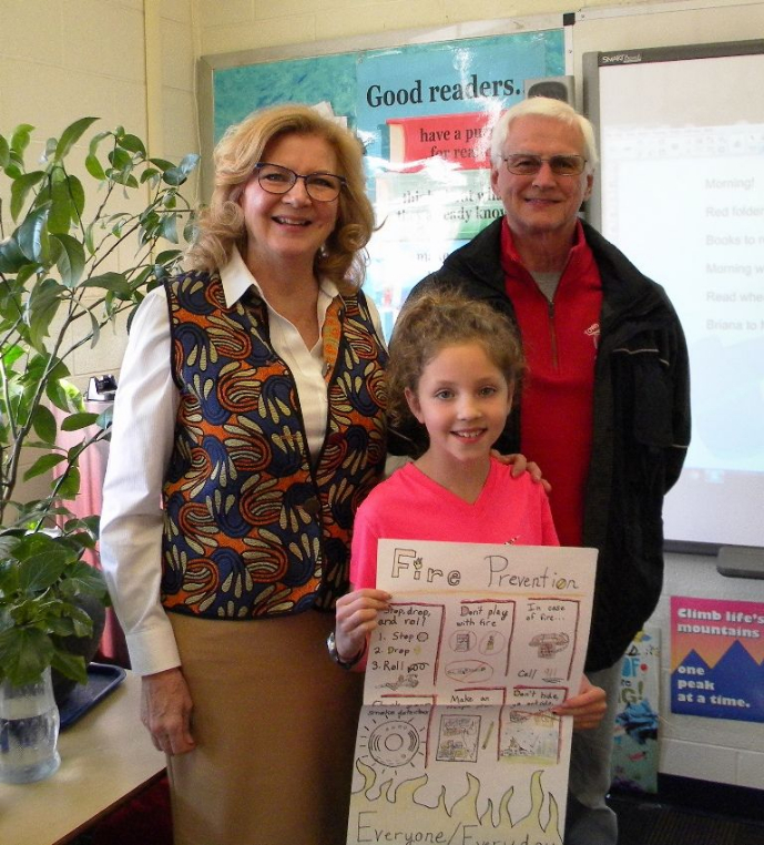 Pomfret Fire Marshal Normand Perron and Selectwoman Maureen Nicholson presented an award to Elise Coyle